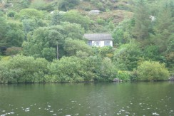Amazing property location with uninterrupted lake views over Lough Currane for sale in Waterville.